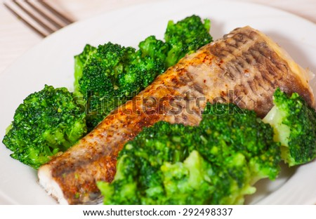 fried fish with broccoli - stock photo