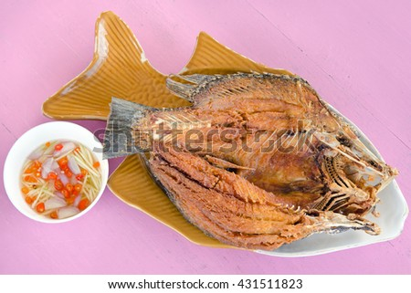 Fried fish with oyster salty sauce - stock photo