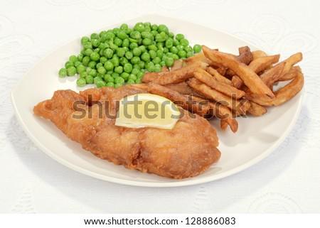 Fried fish with slice of lemon - stock photo