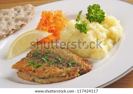 Fried herring with mashed potatoes and grated carrots, Swedish traditional delicacy also called strommingsflundra or herring flounder. - stock photo