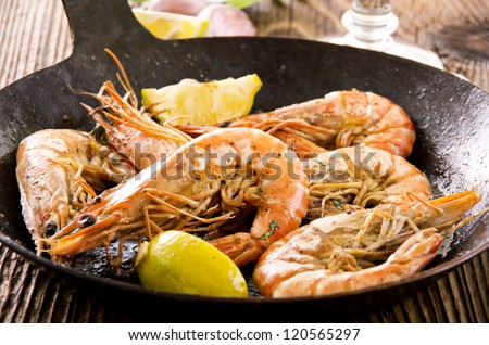 fried king prawns in the iron pan - stock photo