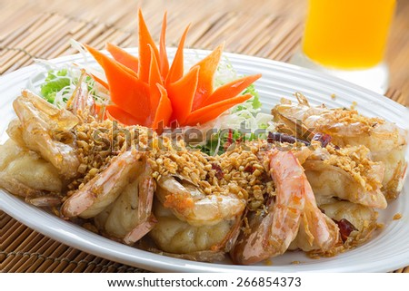 fried king prawns with garlic and herbs - stock photo