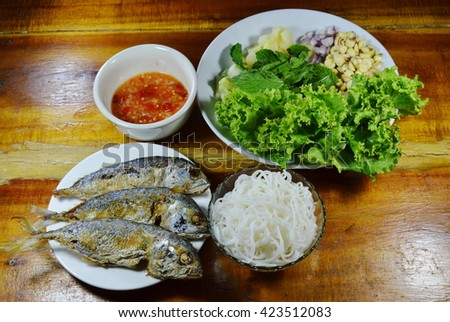 fried mackerel served with fresh vegetable and spicy sauce - stock photo