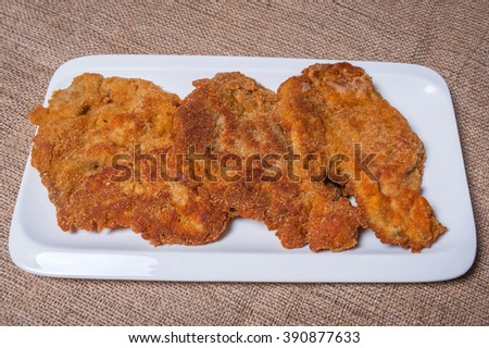 Fried meat cutlets coated in breadcrumbs  - stock photo