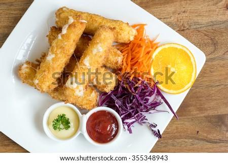 fried mozzarella cheese sticks bread ,Delicious mozzarella fried sticks with sauce - stock photo