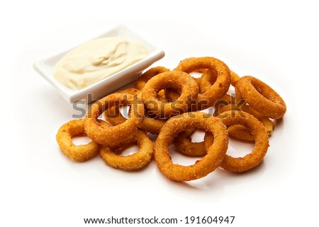 fried onion rings with sauce on a white background - stock photo