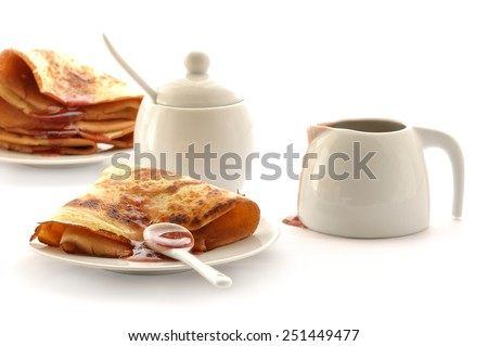 Fried pancake with raspberry jam - stock photo