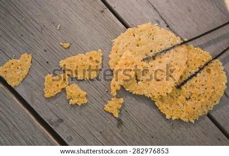 fried parmesan cheese on a wooden background. - stock photo