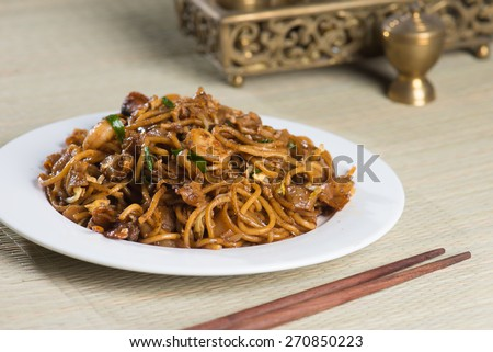 Fried Penang Char Kuey Teow which is a popular noodle dish in Malaysia, Indonesia, Brunei and Singapore  - stock photo