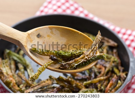Fried Peppers in Wooden Spoon - stock photo