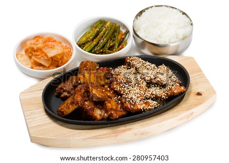 Fried pork ribs with sesame seeds, rice, kimchi and bamboo shoots. From a series of Food Korean cuisine. - stock photo