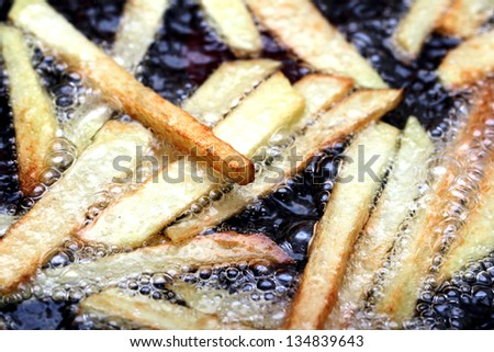 fried potato slices, potato chips - stock photo