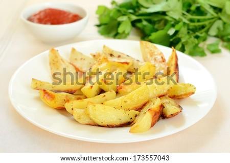 Fried potato wedges on white plate - stock photo