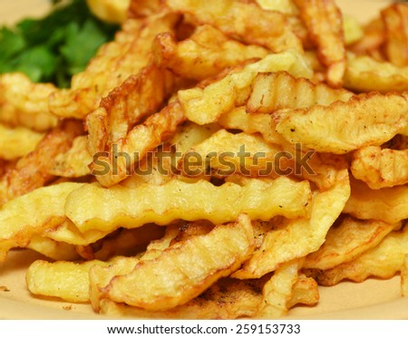 fried potatoes on a plate closeup - stock photo