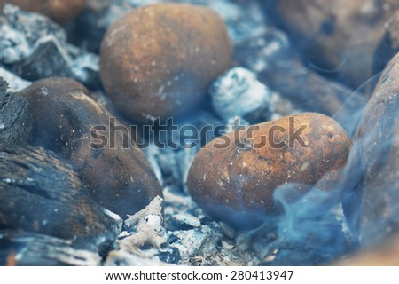 Fried potatoes on the fire - stock photo