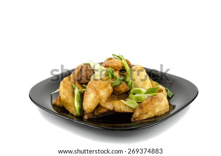 fried potatoes with greens on a plate - stock photo