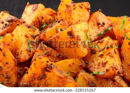Fried potatoes with herbs close up photograph.shallow depth of field photograph.  - stock photo