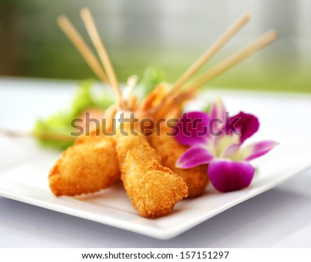 Fried prawn balls with orchid - stock photo
