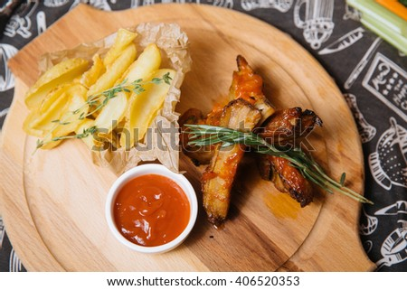 fried ribs with new potatoes - stock photo