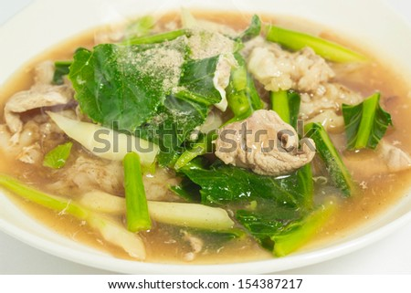 Fried rice noodles topped with pork - stock photo