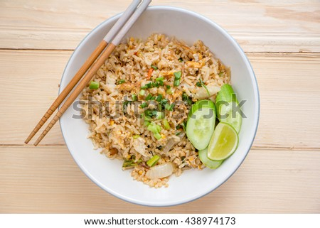 Fried Rice on wood table - stock photo