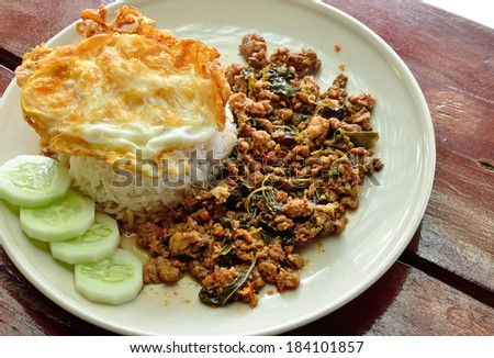 Fried rice with basil, chili and pork (Khao Pad Kra Pao Moo) / Thai Spicy Food - stock photo