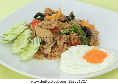 Fried rice with basil, chili and pork (Khao Pad Krapao Moo) / Thai Spicy Food  - stock photo