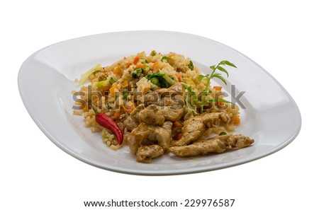 Fried rice with chicken - traditional asian food - stock photo