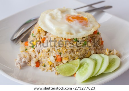 Fried rice with egg on top, Thai food - stock photo