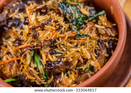 Fried rice with oyster mushrooms and spinach - stock photo