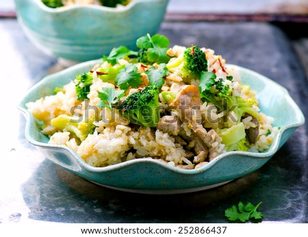 fried rice with pork, vegetables and eggs. Thai cuisine. selective focus - stock photo