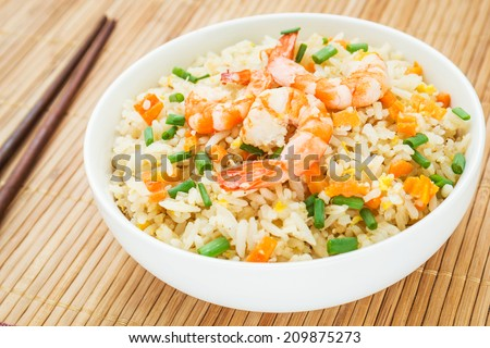 Fried rice with shrimp in bowl  - stock photo