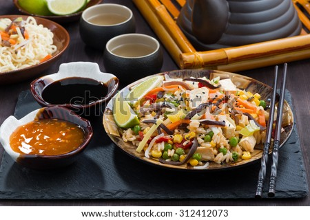fried rice with tofu and vegetables, horizontal - stock photo