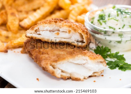 Fried Salmon Filet with Chips and homemade remoulade - stock photo