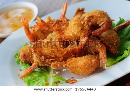 fried shrimp meat ball with sweet sauce on wooden table - stock photo