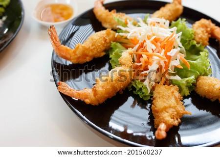 fried shrimp tempura with vegetables on plate. - stock photo