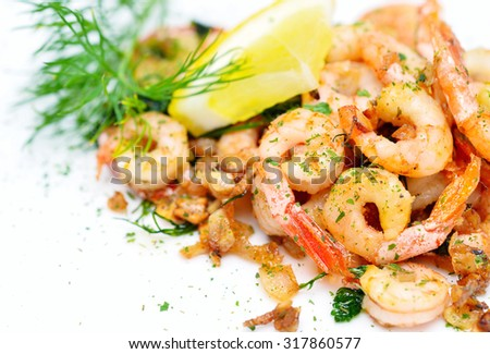 fried shrimps with garlic and fresh dill - stock photo
