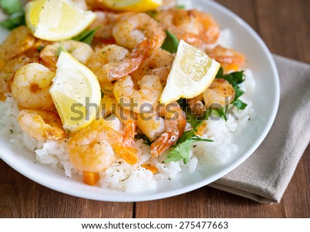fried shrimps with rice and lemons - stock photo