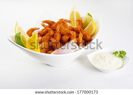 Fried shrimps with tartar sauce - stock photo
