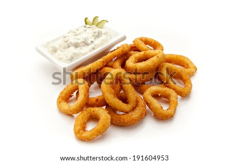 fried squid rings with sauce on a white background - stock photo