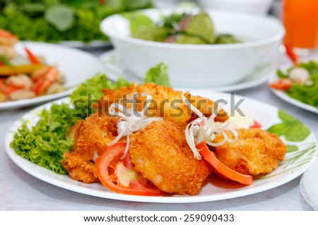 Fried  squid with bread crumbs - stock photo