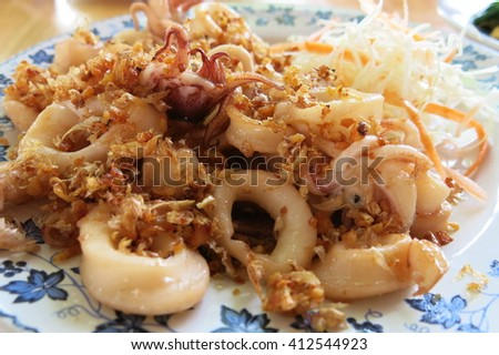 fried squid with garlic - stock photo