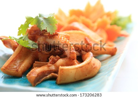 Fried squid with garlic with Vegetables - stock photo