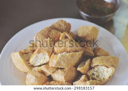 Fried Tofu. Popular Chinese snack. Toned image. - stock photo