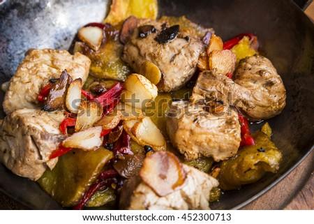 Fried tuna pieces with garlic - stock photo
