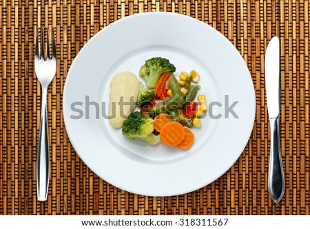Fried vegetables on the plate in closeup - stock photo