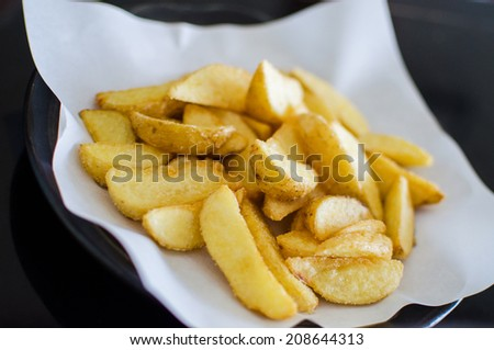 Fried wedges potato - stock photo