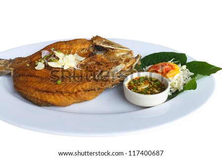 Fried white perch Fish with Fish sauce, delicious thai food. - stock photo