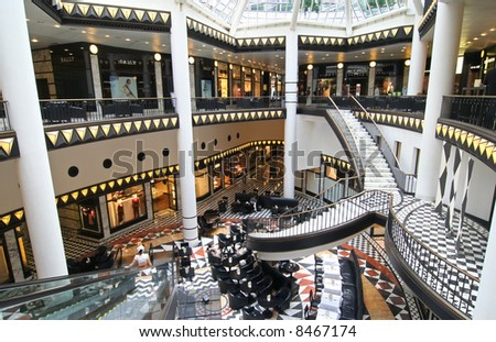 Friedrichstrasse shopping mall and cafetaria in Berlin - stock photo