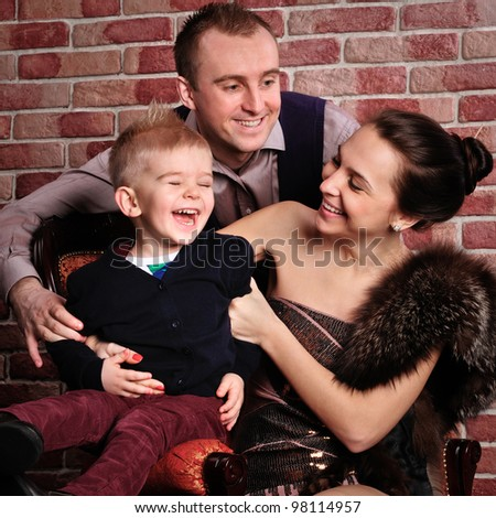 friendly and happy family, a wife with her husband and little boy. fun to laugh - stock photo